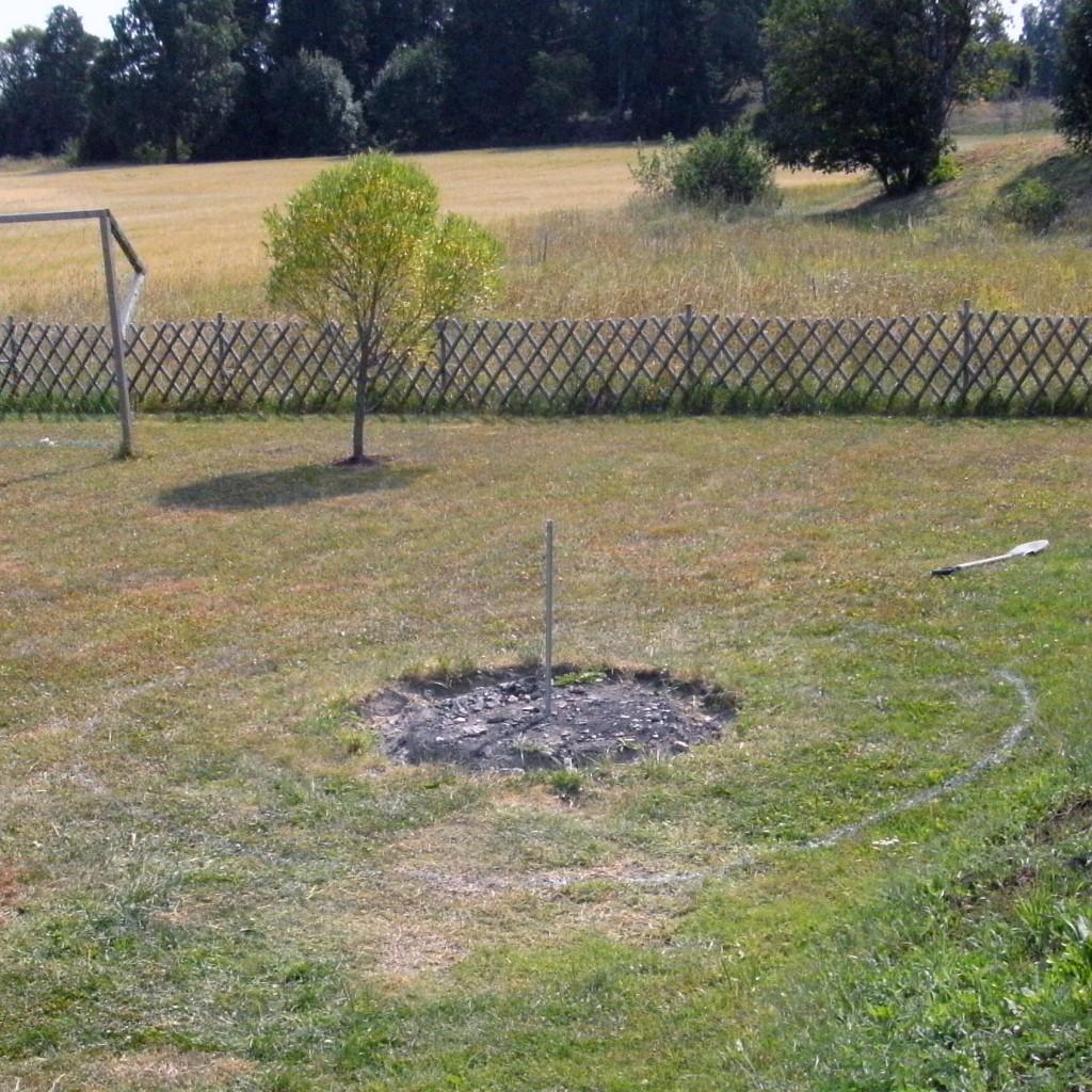 markering av plats i gräsmattan