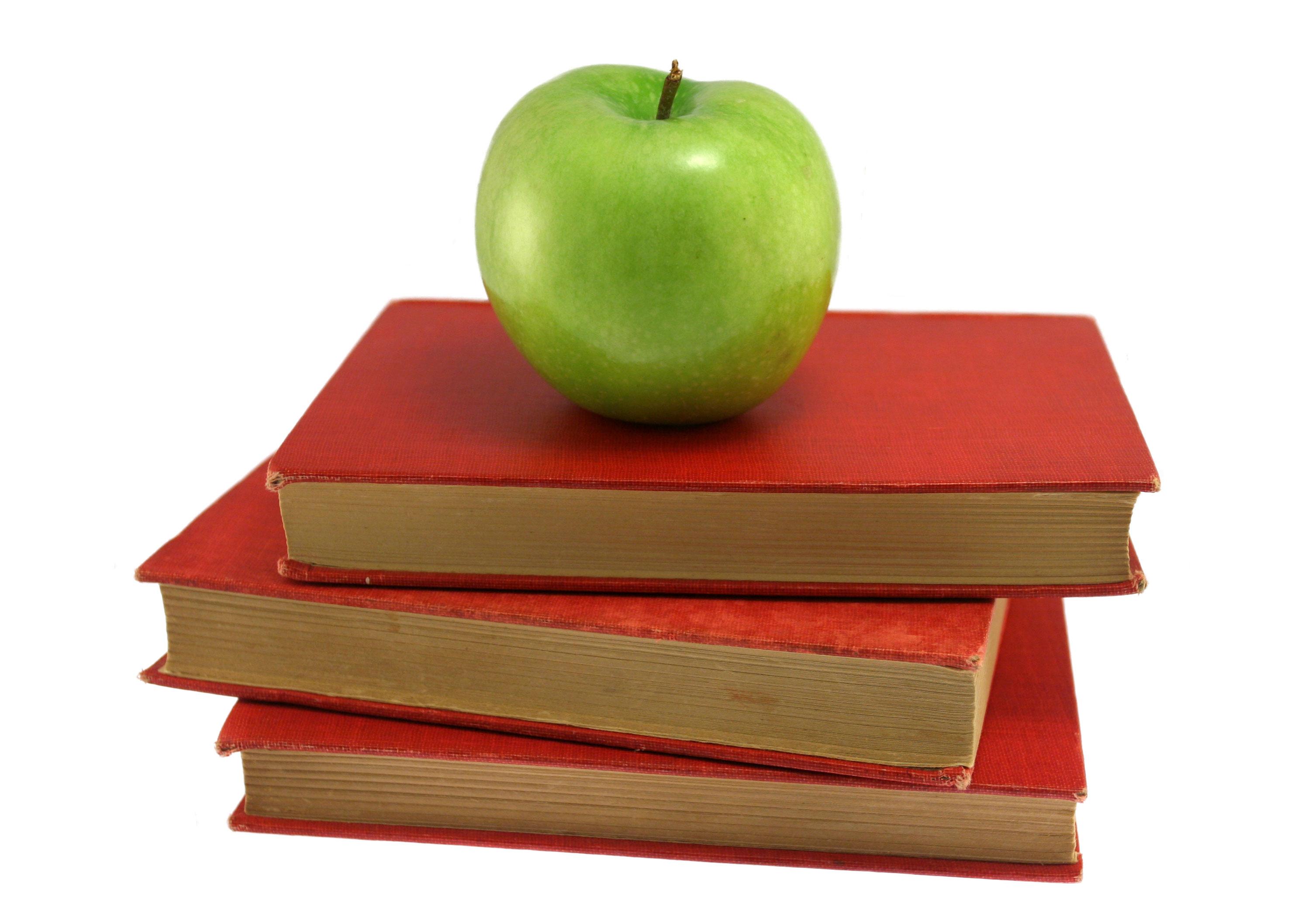 Äpple på böcker